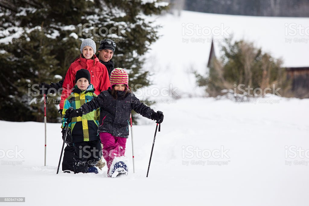 Family Doing snowshoeing stock photo