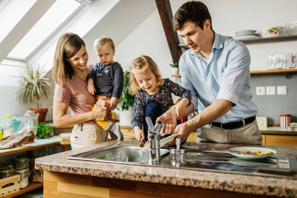 Family doing the dishes together stock photo