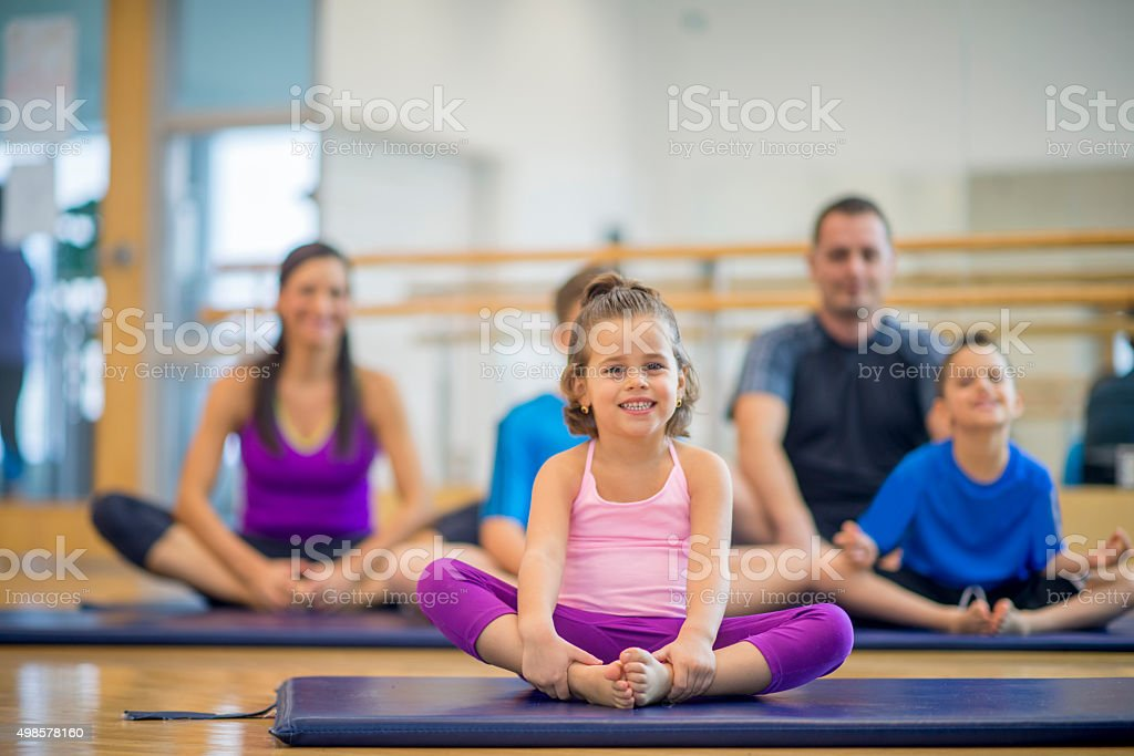 Family Doing Toga Together at the Gym stock photo