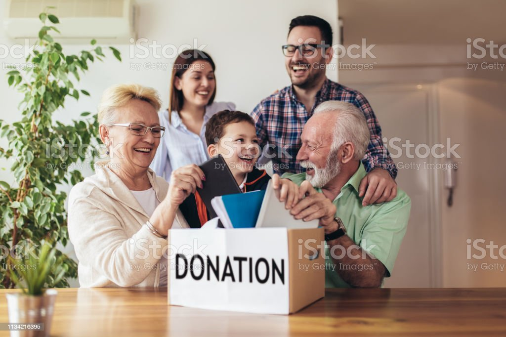 Family donating unwanted items. stock photo