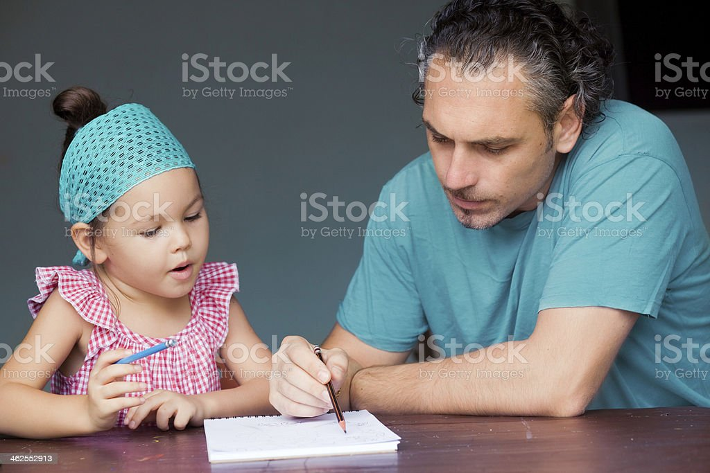 Family draw and write together stock photo