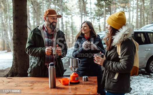 Photo of family drinking hot tea on a cold day