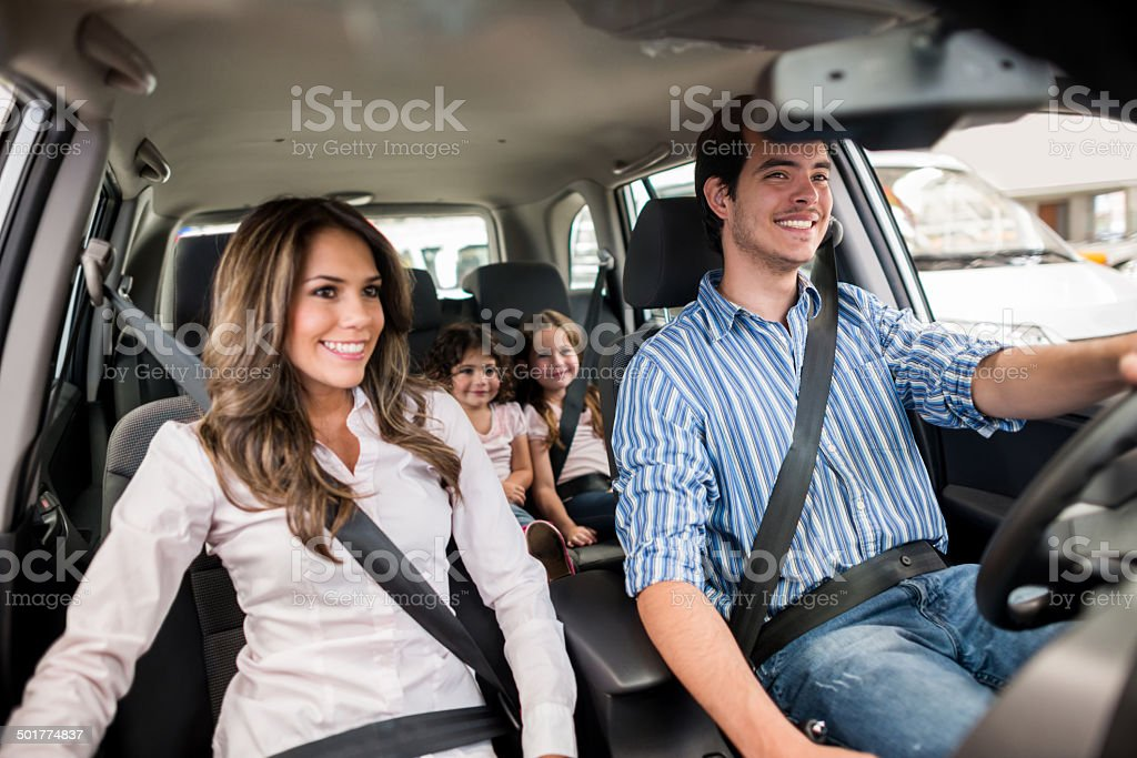Family driving a car stock photo