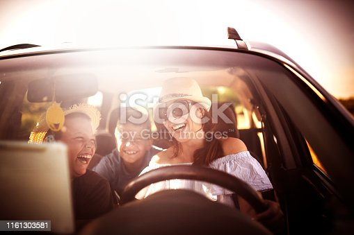639770050 istock photo Family Driving In  Car On Countryside Road Trip 1161303581