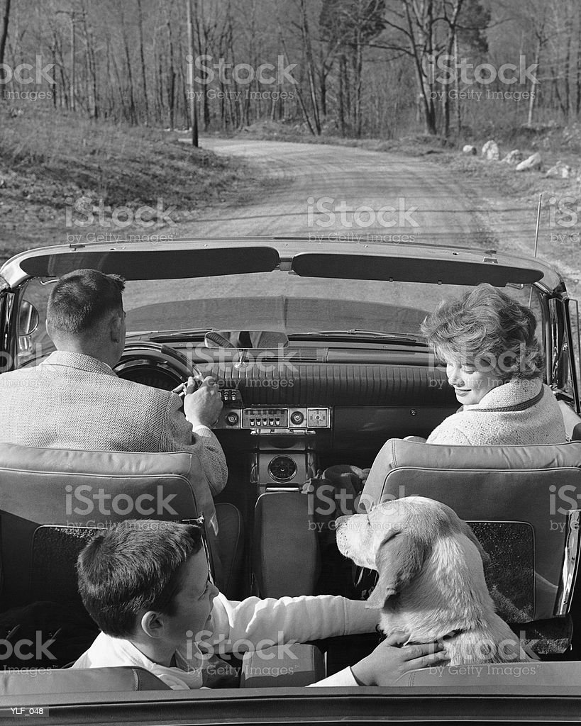 Family driving in convertible along country road royalty-free stock photo