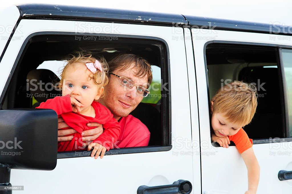 family driving off-road car on tropical beach stock photo