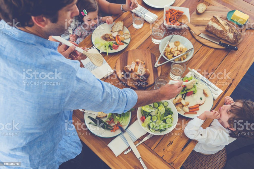 Family eating a meal at the table. royalty-free stock photo