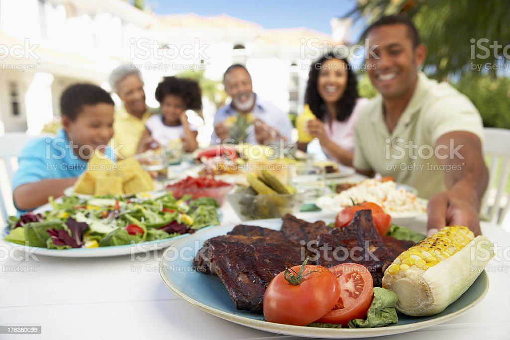 Family Eating An Al Fresco Meal royalty-free stock photo