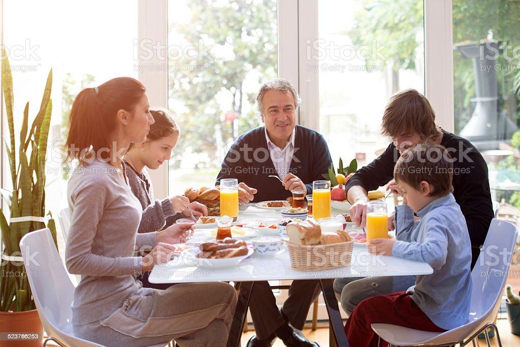 family eating breakfast stock photo