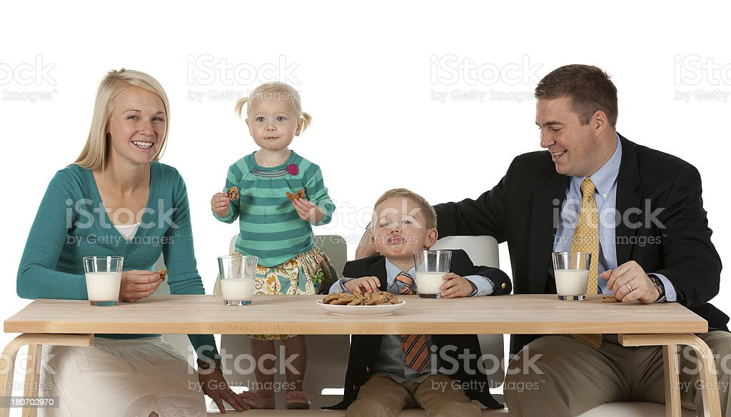 Family eating cookies with milk royalty-free stock photo