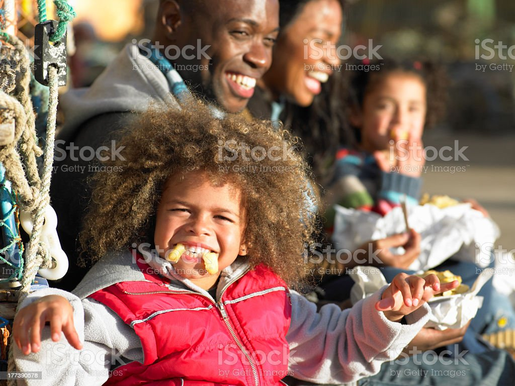 A family eating fish and chips royalty-free stock photo