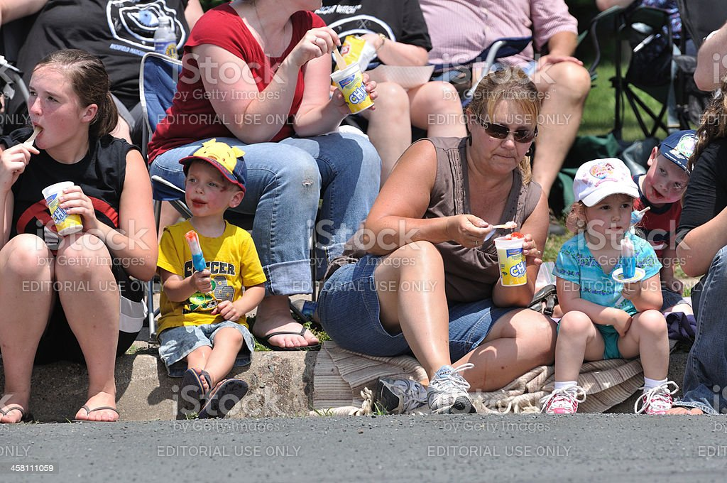 Family Eating Frozen Treats While Watching Parade Stock Photo More