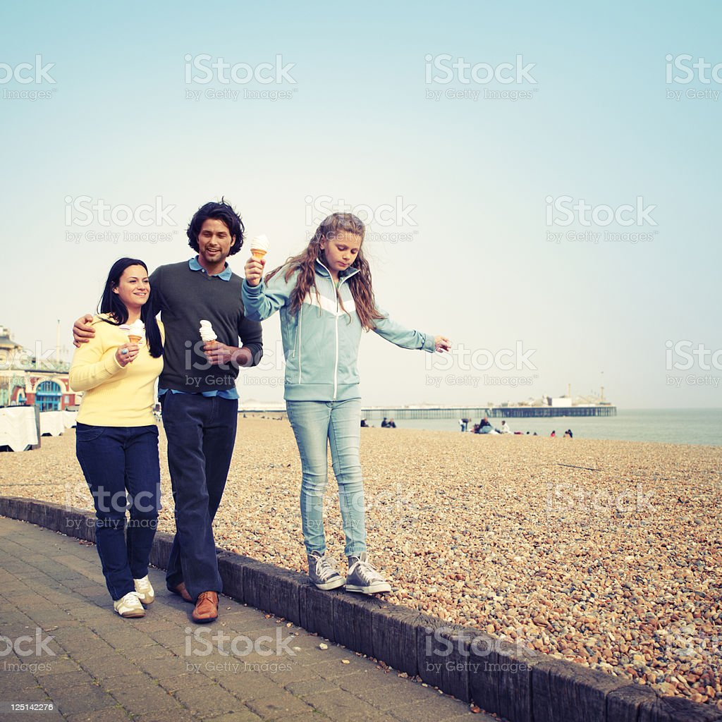Family Eating Ice Cream at the Beach stock photo
