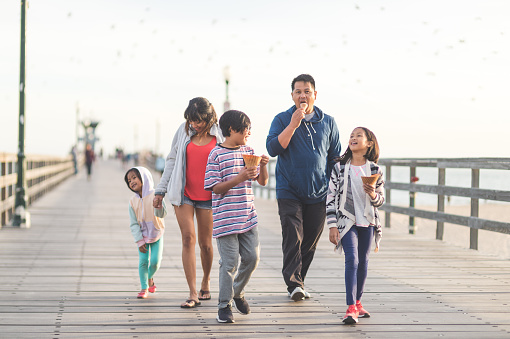 Family Eating Ice Cream On A Beach Boardwalk Stock Photo ...