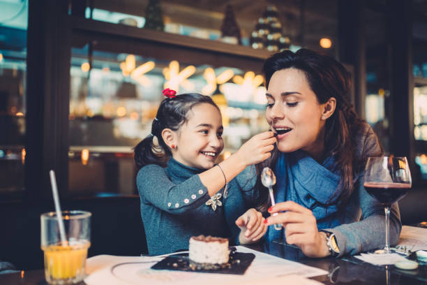 Family eating in restaurant stock photo
