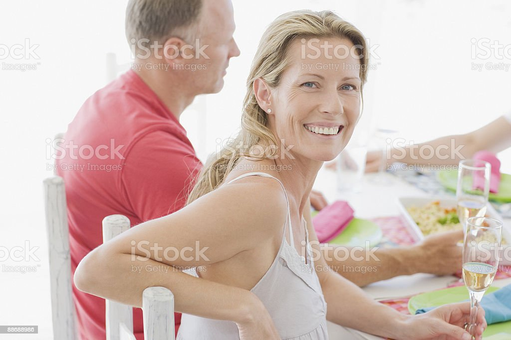 Family eating lunch outdoors royalty-free stock photo