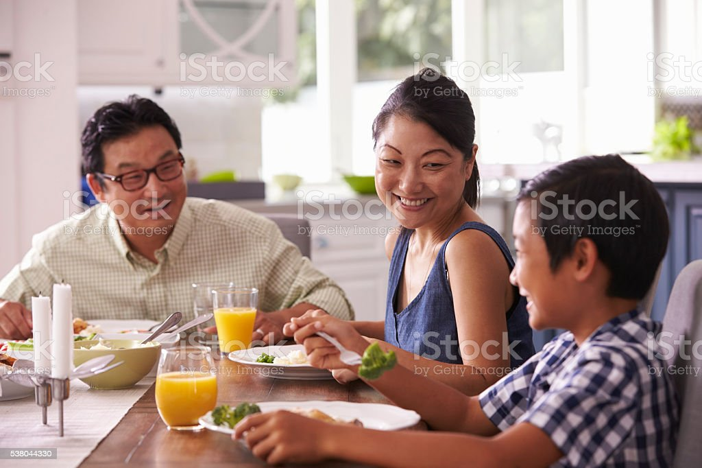 Family Eating Meal At Home Together stock photo