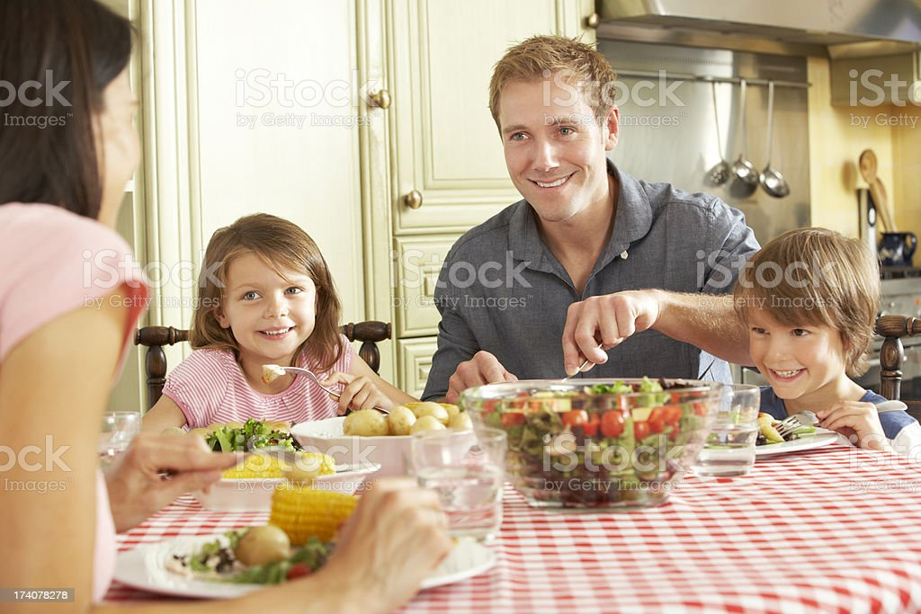 Family Eating Meal Together In Kitchen royalty-free stock photo