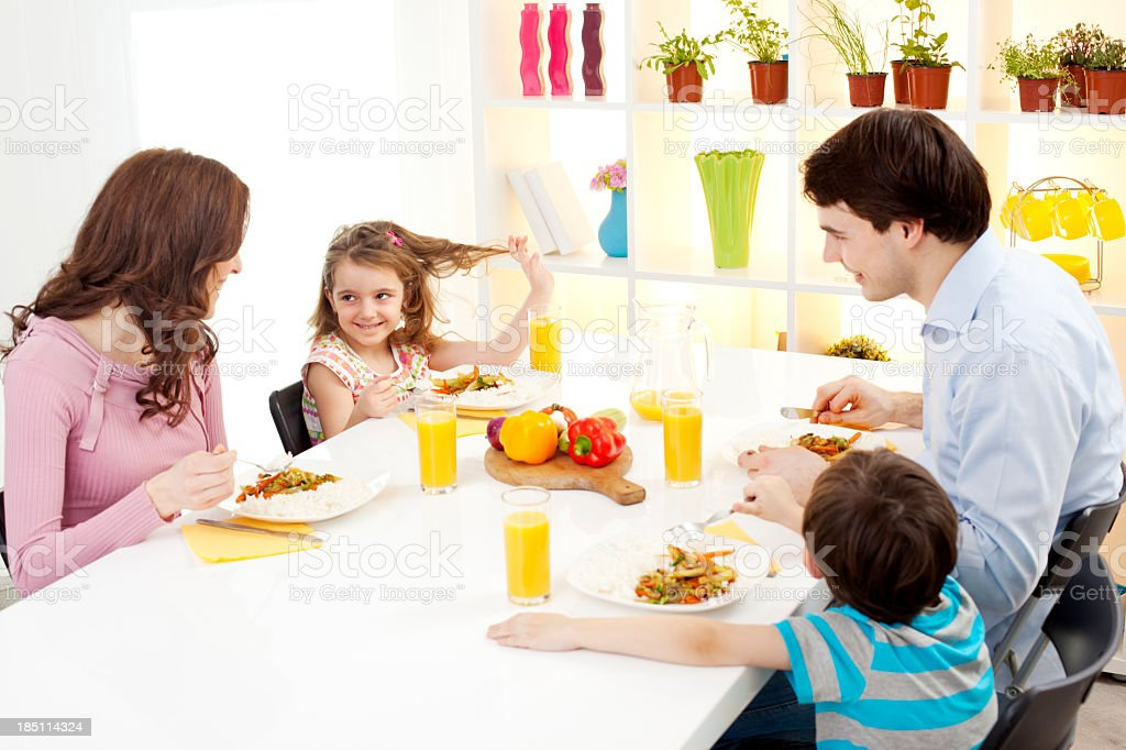 Family eating meal together royalty-free stock photo