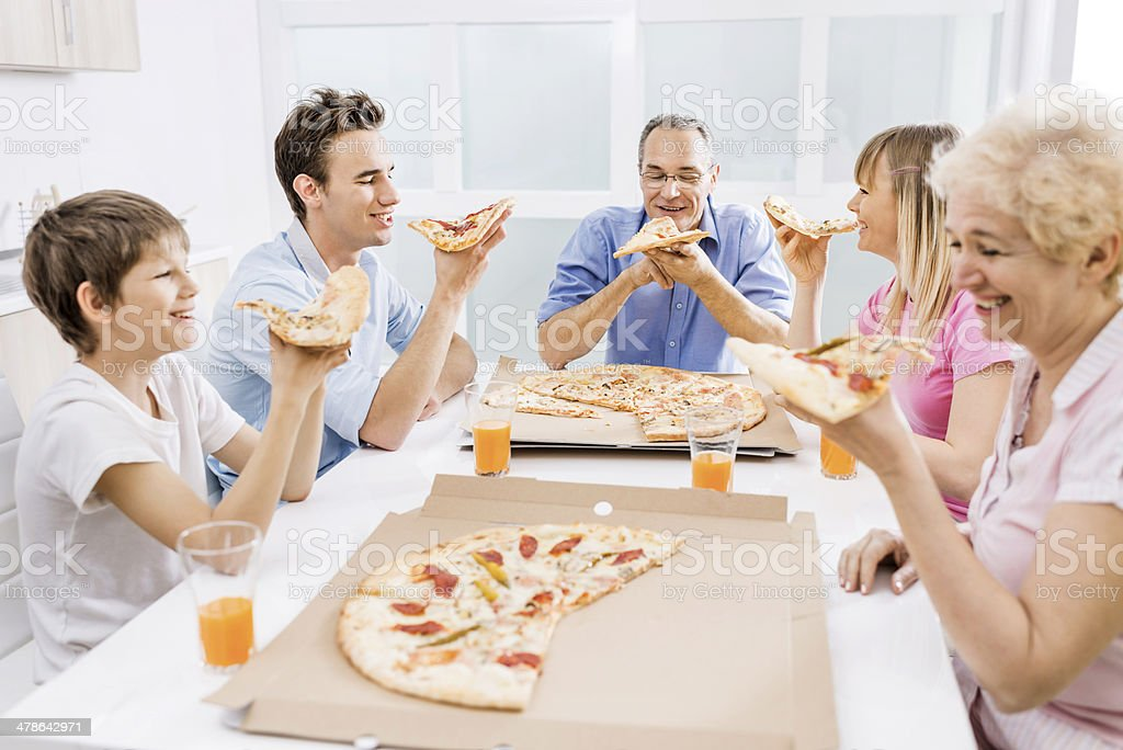 Family eating pizza for lunch. royalty-free stock photo
