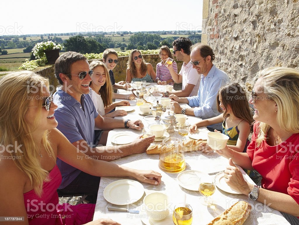 Family eating together outdoors royalty-free stock photo
