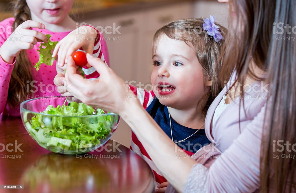 Family eating vegetable salad stock photo