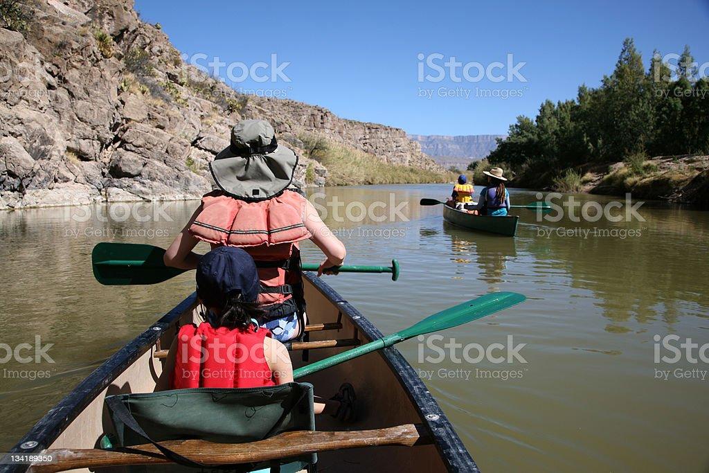 Family Enjoy Canoeing royalty-free stock photo