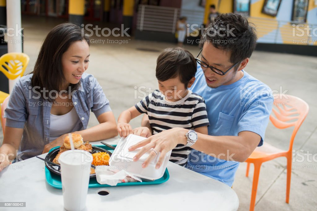 Family enjoy eating at shopping mall stock photo