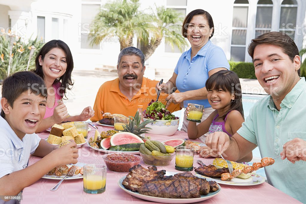 Family Enjoying A Barbeque royalty-free stock photo