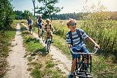 istock Family enjoying a bike trip 1179742816