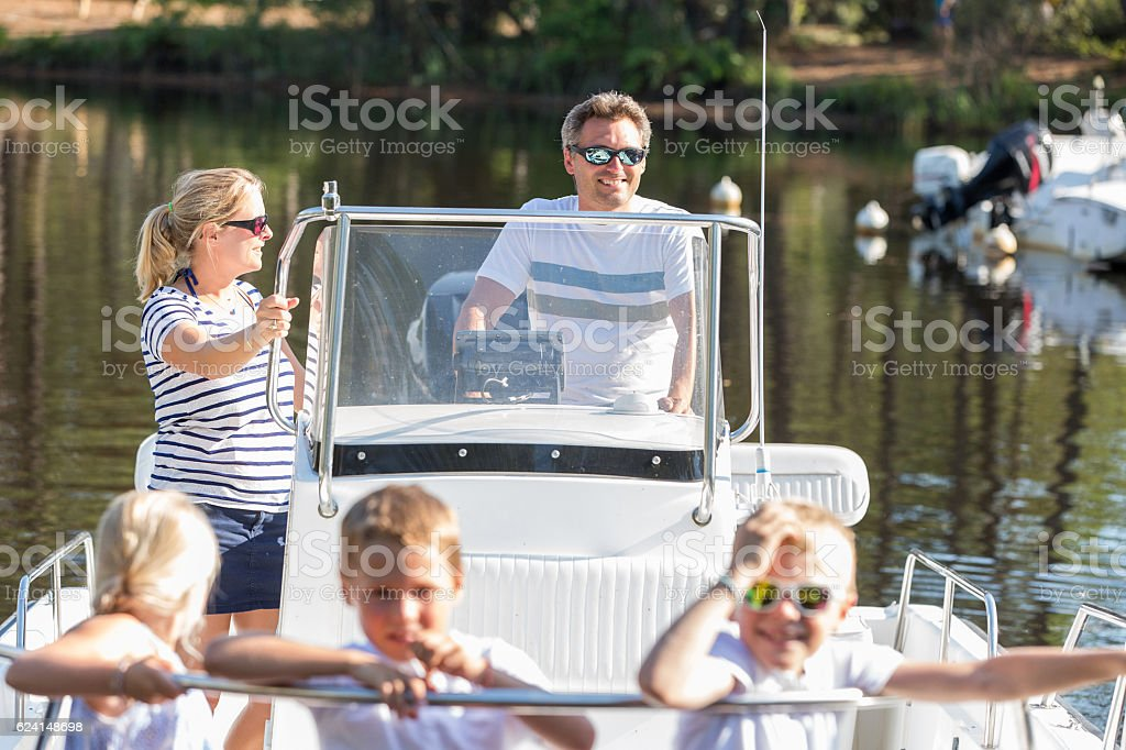 family enjoying a summer day on a boat - Photo