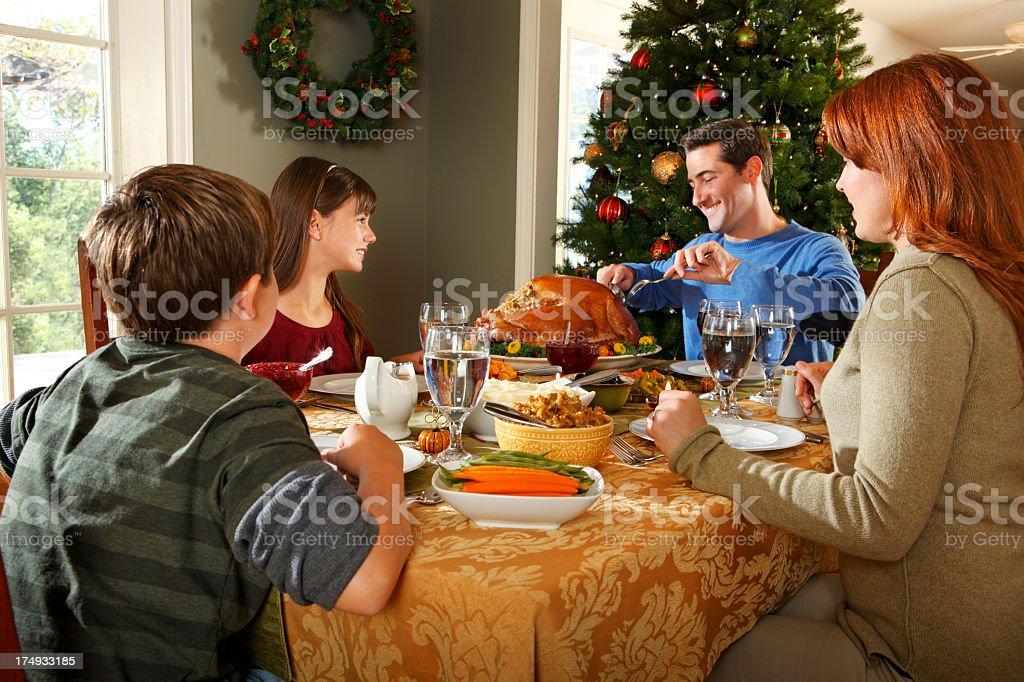 Family enjoying a Thanksgiving or Christmas dinner royalty-free stock photo