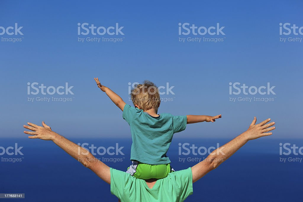 Family enjoying a vacation by the sea royalty-free stock photo