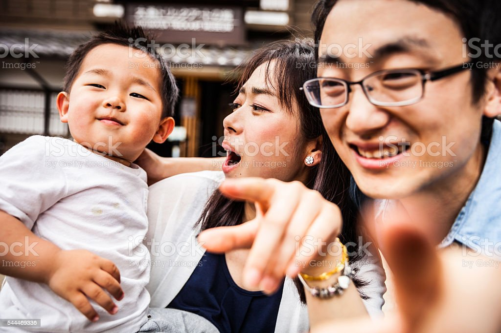 Family enjoying a visit to Kyoto historical old town, Japan stock photo