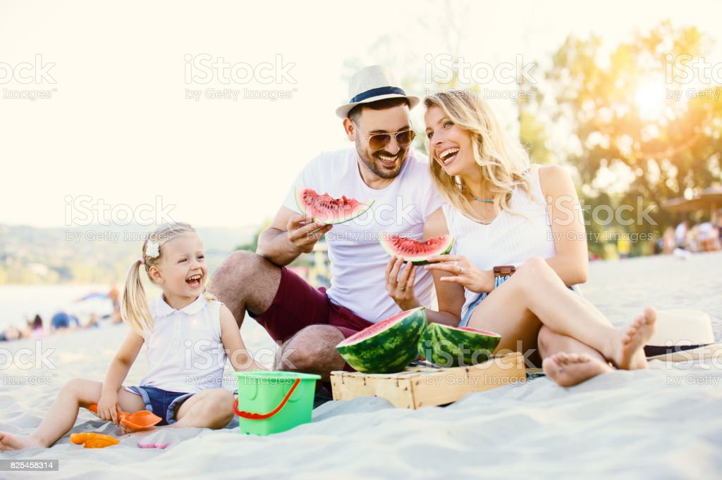 Family enjoying beach stock photo