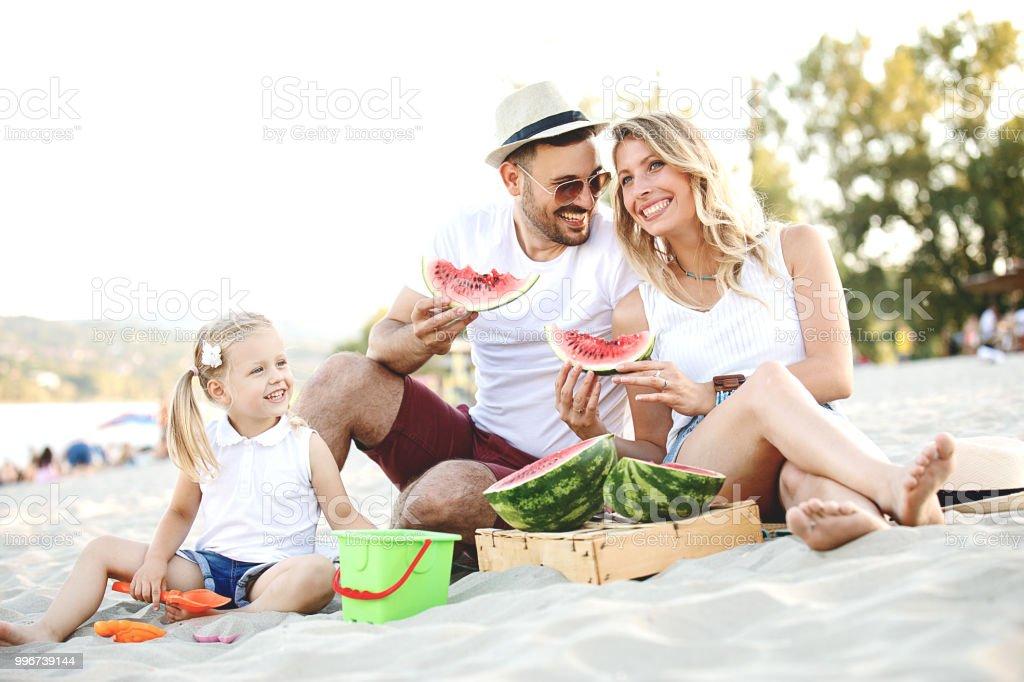 Family enjoying beach stock photo