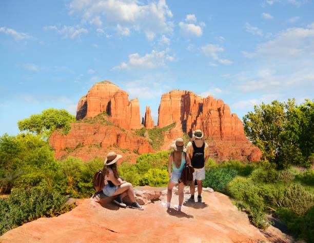 Family enjoying beautiful mountain view on summer hiking trip. stock photo