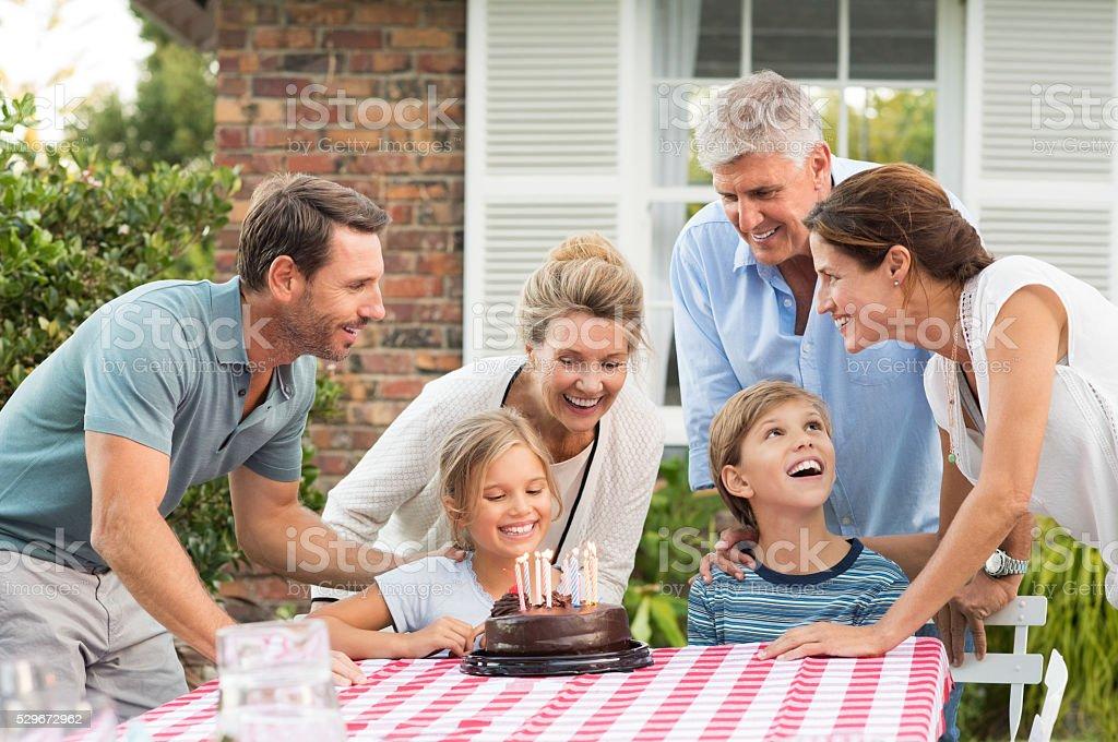 Family enjoying birthday party stock photo