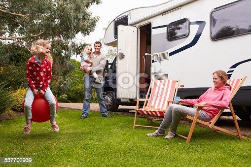 istock Family Enjoying Camping Holiday In Camper Van 537702939