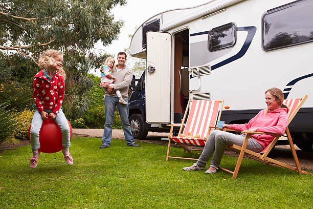 family enjoying camping holiday in camper van - motorhome stock photos and pictures