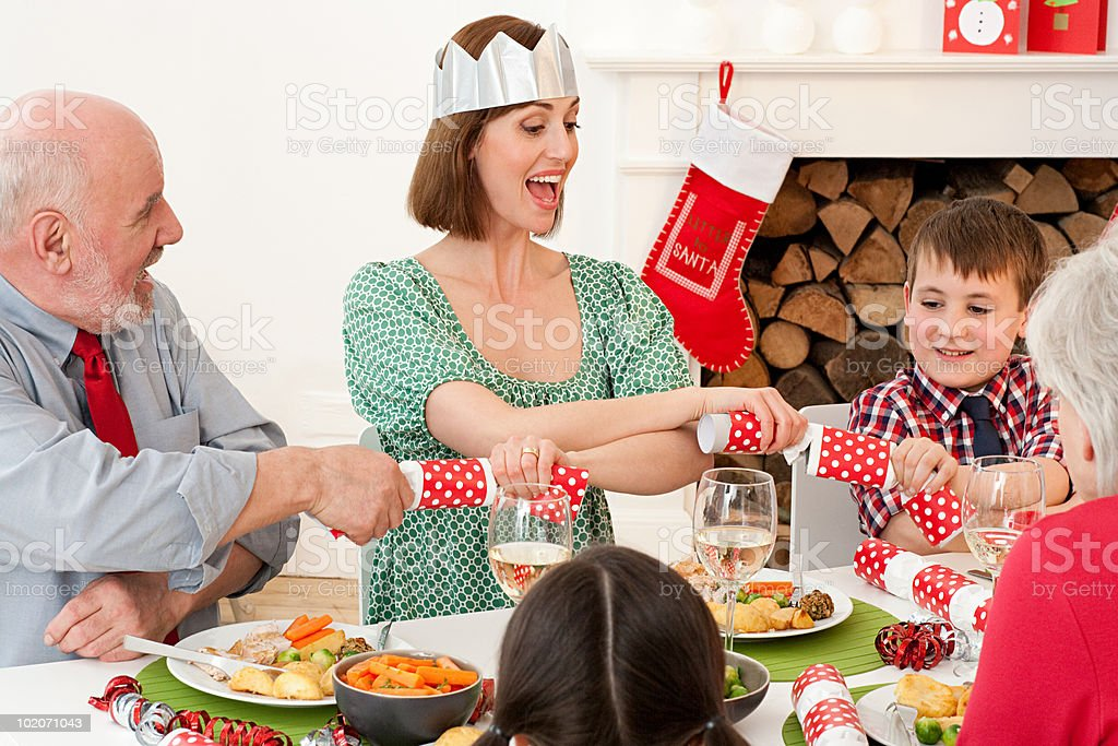 Family enjoying Christmas dinner stock photo