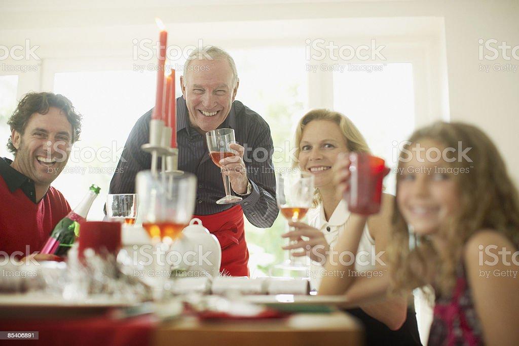 Family enjoying Christmas dinner royalty-free stock photo