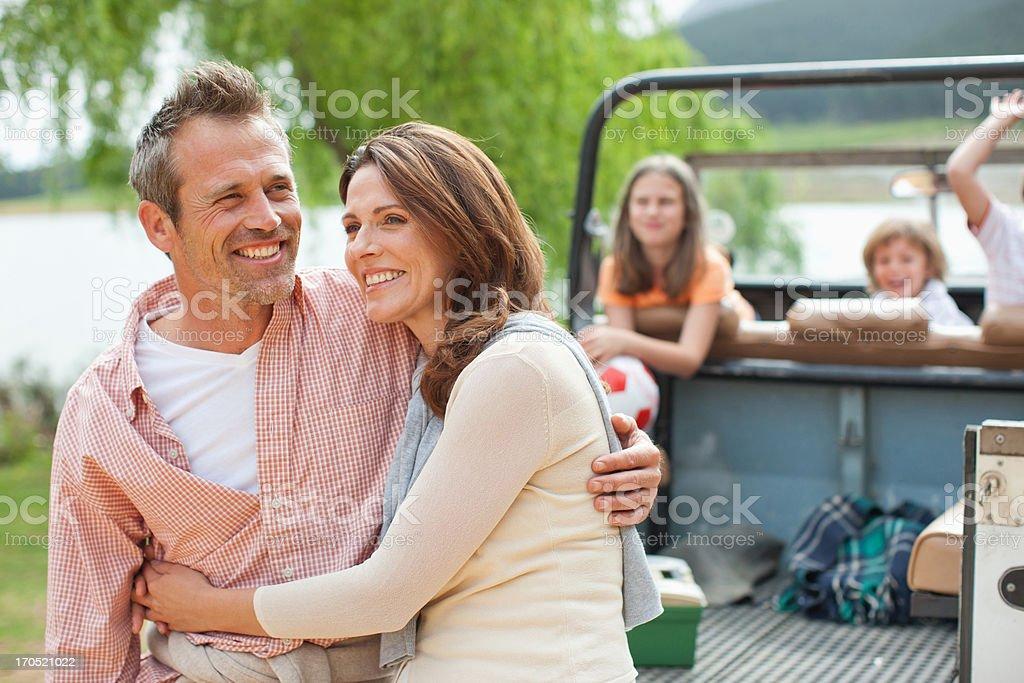 Family enjoying day at lake stock photo
