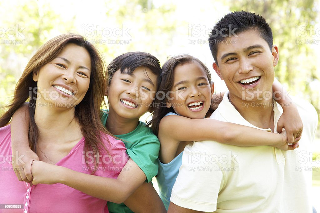 Family Enjoying Day In Park stock photo