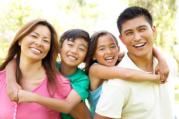 Family Enjoying Day In Park  filipino ethnicity stock pictures, royalty-free photos & images