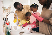 Close up of a family washing dishes together