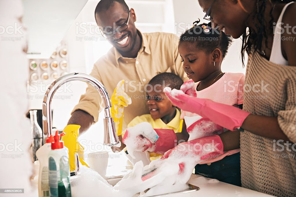 Family enjoying dishwashing stock photo