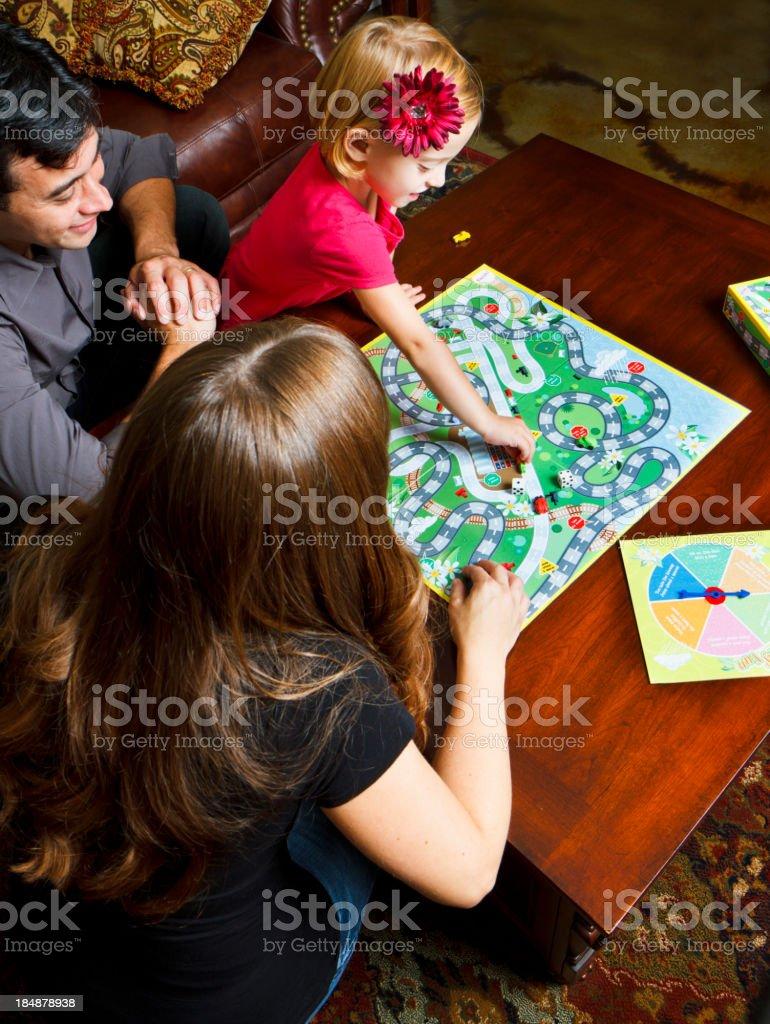 Family enjoying game night together stock photo