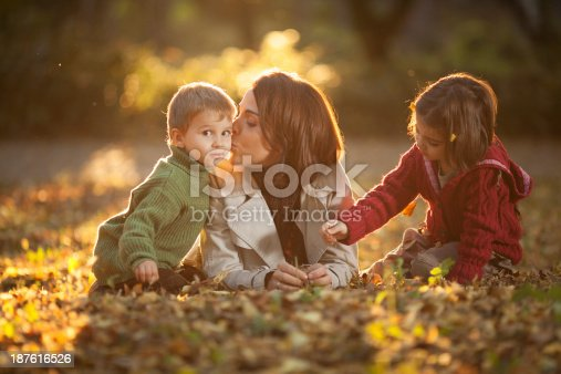 172407626istockphoto Family enjoying in a autumn park. 187616526