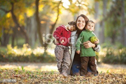 172407626istockphoto Family enjoying in a autumn park. 187781400